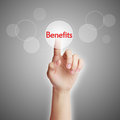 Benefits concept hand pressing virtual button of with gray background Stock Photography