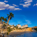 Benidorm alicante playa del mal pas beach sunset at in spain with palm trees Royalty Free Stock Photo