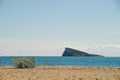 Benidorm beach in a sunny day and its landmark island with lonely sunbather Royalty Free Stock Photos