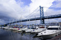 Benjamin franklin bridge and yachts near Stock Photography