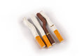 Bent and Broken Cigarettes on a White Background Royalty Free Stock Images