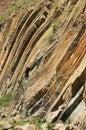 Bent hexagonal columns of volcanic origin at the Hong Kong Global Geopark in Hong Kong, China. Royalty Free Stock Photo