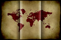 Bent paper world map in red color on damaged Royalty Free Stock Photography