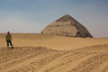 Bent pyramid at the bottom tourist on road to and ancient egyptian located royal necropolis of dahshur built under Royalty Free Stock Images