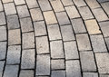 Bent rows of grey cobble pavement Royalty Free Stock Photo
