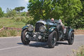 Bentley litre s c in mille miglia the crew w schreiber b ostman on a vintage racing car travels tuscany during the italian Royalty Free Stock Photography