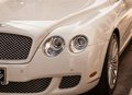 Bentley luxury car a stunning white new sporty just off the showroom floor waits for its new owner Royalty Free Stock Photography