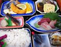 Bento box a typical lunch in japan containing tasty items such as sashimi tamago and oysters Royalty Free Stock Image
