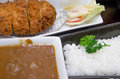 Bento japanese food style deep fried pork with curry and stream rice serve with salad and soup tonkatsu curry meal set Royalty Free Stock Images