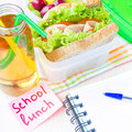 Bento lunch for your child in school box with a healthy sandwic sandwich and fruit salad and apple juice the bottle drinking Stock Images