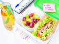Bento lunch for your child in school box with a healthy sandwic sandwich and fruit salad and apple juice the bottle drinking Royalty Free Stock Photos