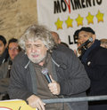 Beppe grillo portrait with microphone is a leader of political movement called stars movement he is famouse for the energy Stock Image