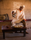 Berber tea a man performs the traditional ceremony of making mint ait ben haddou morocco Stock Images