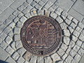 Bergen norway manhole cover in with beautiful engraving Stock Photo