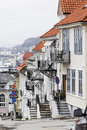 Bergen street with pretty whitewashed houses and iron balconies norway Royalty Free Stock Image