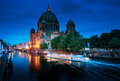 Berlin Cathedral with excursion boat on Spree river,