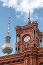 Berlin city hall and tv tower detail of the brick single clock building of the the germany Royalty Free Stock Image