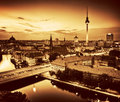 Berlin germany major landmarks at sunset in gold tone rooftop view on television tower cathedral rotes rathau and the river spree Royalty Free Stock Image