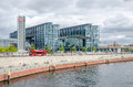Berlin Hauptbahnhof with sightseeing bus and quayside of the ri