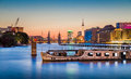 Berlin skyline with old ship wreck in Spree river at dusk, Germany