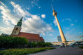 Berlin tv tower and a church in front of a blue sky Royalty Free Stock Images