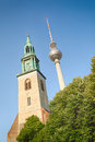 The berlin tv tower next to st mary s church photographed in germany Stock Images
