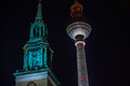 Berlin tv tower at night with a turret from a church Stock Photography