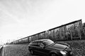 Berlin wall with car abstract image of german old and new concept typical modern german moving in front of famous landmark of the Royalty Free Stock Images
