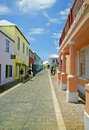 Bermuda one of s many narrow colorful streets with buildings sporting tropical colors Stock Photos