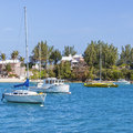 Bermuda pleasure boats moored along the shoreline of Stock Image