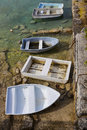 Bermuda rowboats tied up at a low tide Stock Photos