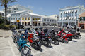 Bermuda s popular means of transportation is the scoter here scoters are parked on front street in the city of hamilton Stock Photos