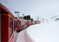 Bernina express train in winter time the red between tirano italy and sankt moritz switzerland a snowy landscape Stock Image