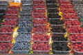 Berries bowls with fresh blackberries raspberries and blueberries on the market stall Royalty Free Stock Images