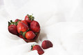 Berries of bright juicy strawberries in white milk or cream Royalty Free Stock Photo