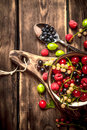 Berries in a Cup on the Board. Royalty Free Stock Photo