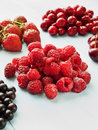 Berries different kinds of on the blue background shallow dof Royalty Free Stock Image