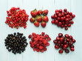 Berries different kinds of on the blue background viewed from above Royalty Free Stock Images