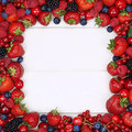 Berries fruits frame with strawberries, blueberries, cherries an Royalty Free Stock Photo