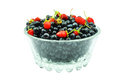 Berries in a glass dish blueberries and strawberries on white background Stock Photo