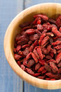 Berries goji in bowl on blue Royalty Free Stock Photo