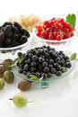 Berries hill ripe in a crystal vase on a white background Royalty Free Stock Photo