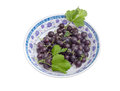 Berries of jostaberry and leaves in a bowl Royalty Free Stock Photo