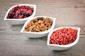 Berries on old wooden background superfoods superfood in bowls Royalty Free Stock Images