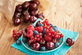 Berries on table in saucer wooden fruits cherry raspberry and blueberry Royalty Free Stock Image