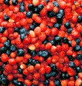 Berry background of strawberries and blueberries