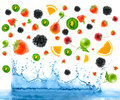 Berry falling in juice. Isolation Stock Photo