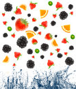 Berry and fruit falling in juice. Royalty Free Stock Photo