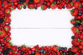 Berry fruits frame with strawberries, blueberries, cherries and Royalty Free Stock Photo