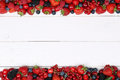 Berry fruits frame with strawberries, raspberries, cherries and Royalty Free Stock Photo